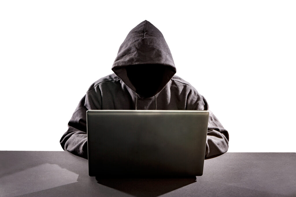 Hacker using laptop. Hacking the Internet.