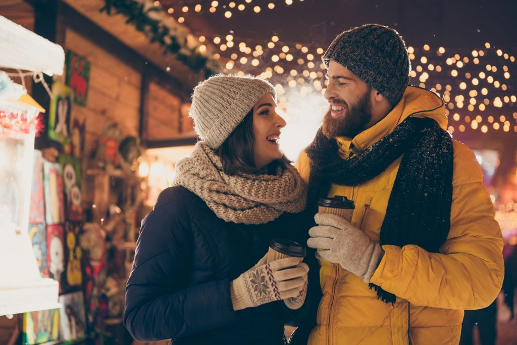 Photo of two people cute couple husband guy wife lady drink hot beverage x-mas, eve spend time magic land newyear shopping market buying gifts wear coats outside