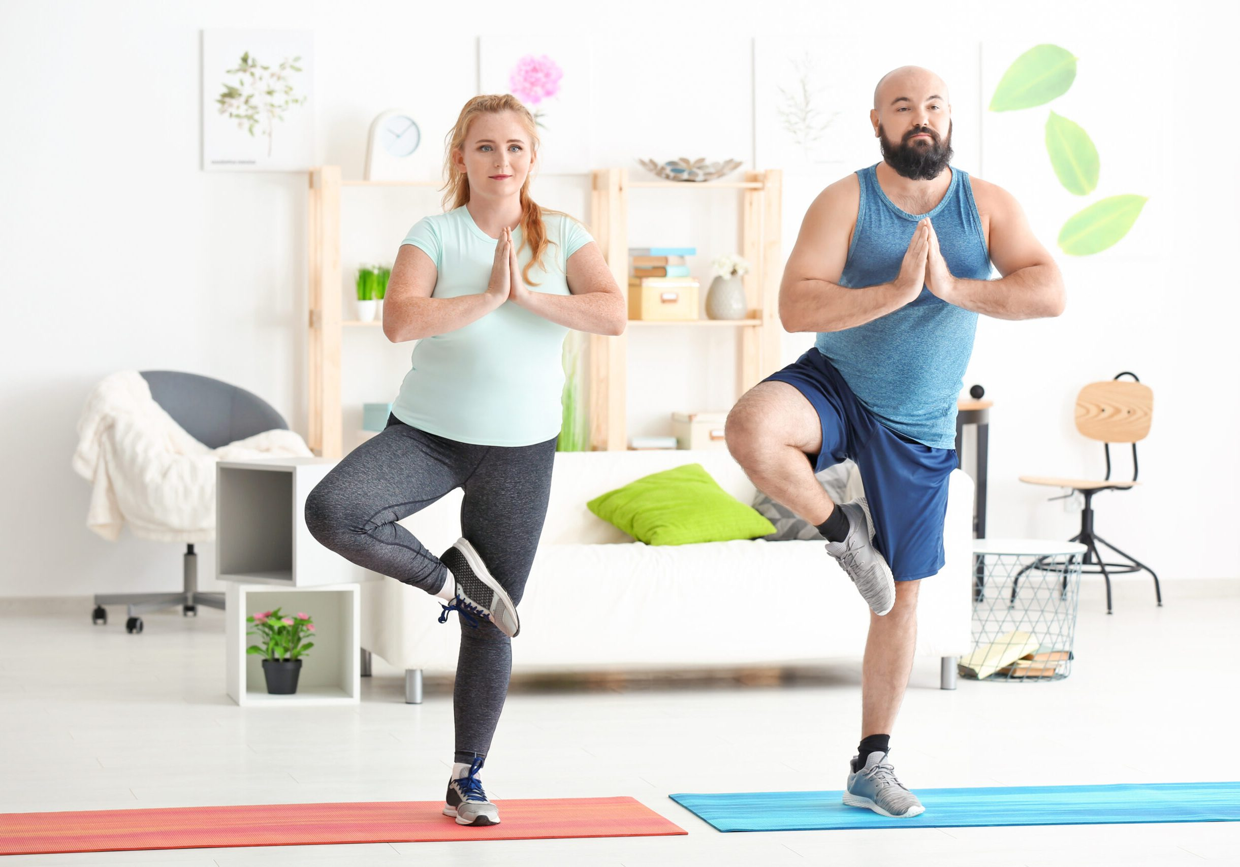 Overweight couple doing exercises at home