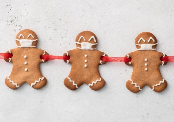 Stay home quarantine from Covid-19. Christmas gingerbread men with a masks